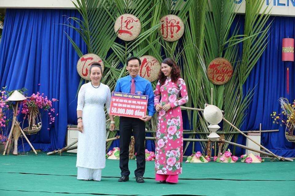 """images_2018_02_tet_xua_phuoc_tien_tet_xua_4_1d9a2 Học sinh """"Tiểu học Phước Tiến"""" hóa thân vào Lễ hội Tết xưa."""